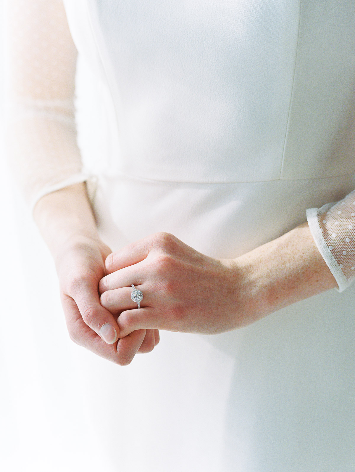 Detail shot of a bride's engagement ring on her hand, the morning of her wedding