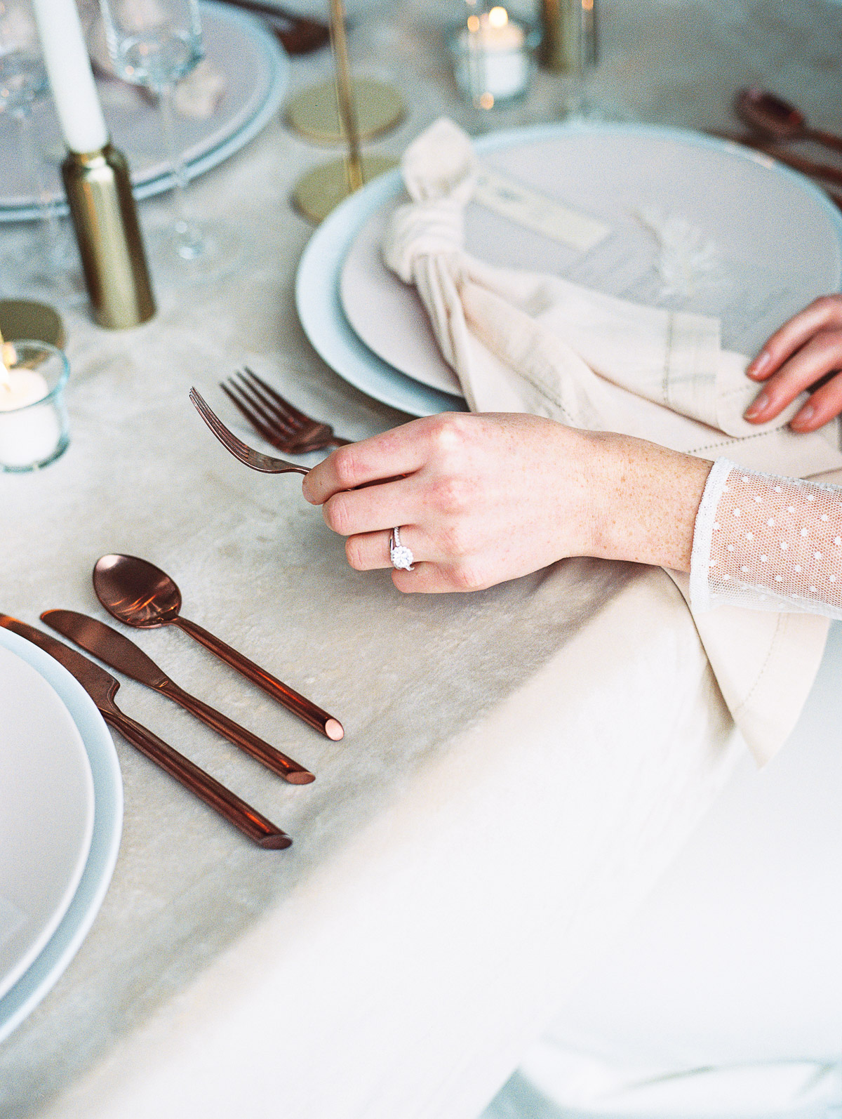 A beautiful tablescape, featuring a Portland Oregon Bride reaching for her silverware