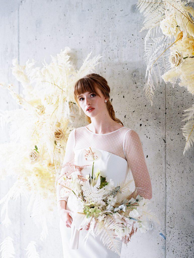 Bride stands in front of Wildflower PDX floral installation during her Jupiter Hotel Portland Oregon Wedding