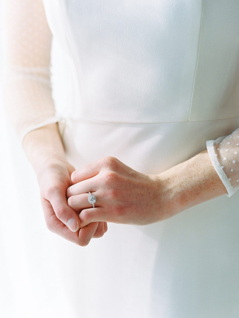 Close up shot of a brides modern engagement ring on her wedding day