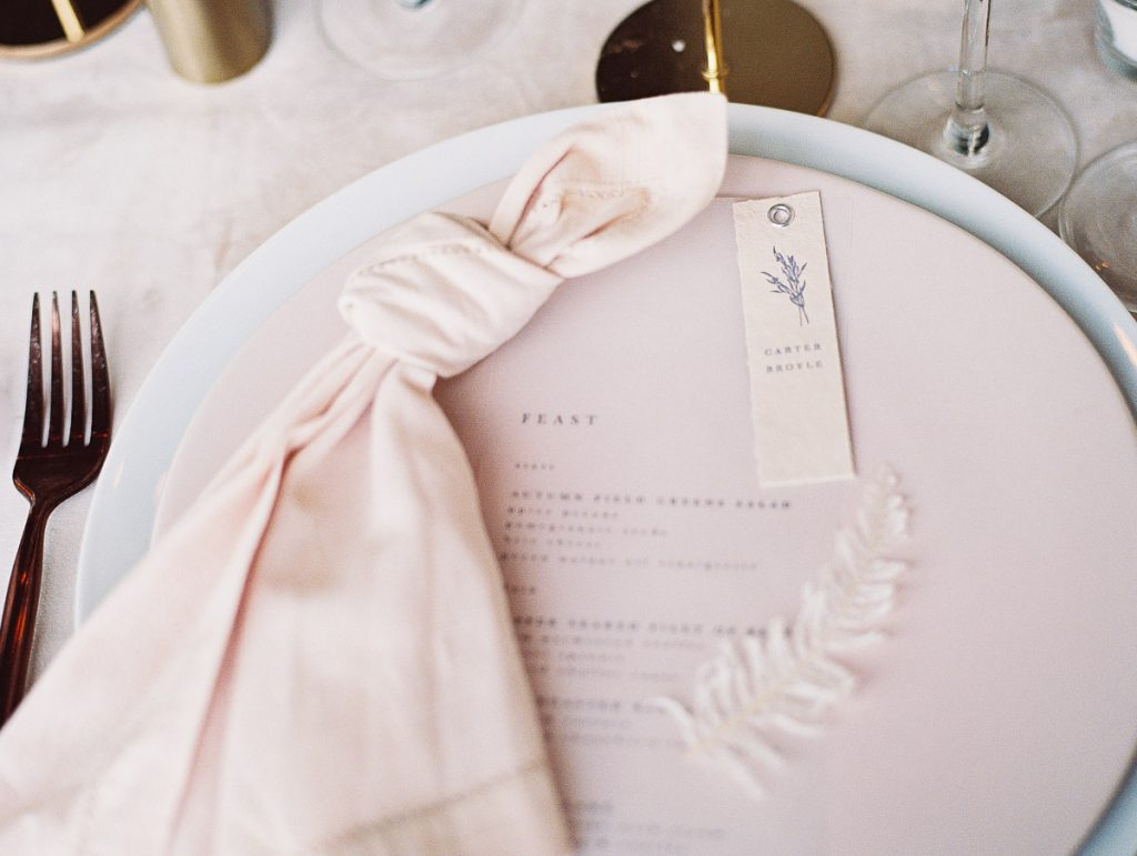 Close up shot of the wedding menu, designed by Portland calligrapher letters and dust