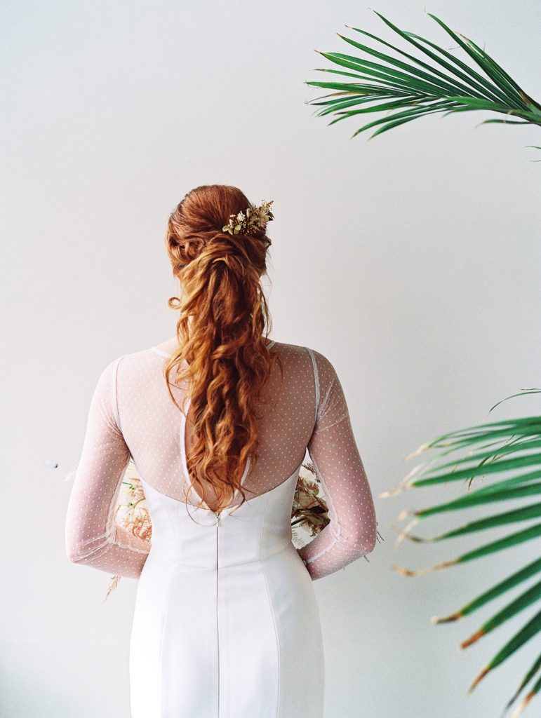 Detail photo of the brides red hairstyle, done by Beth Chan