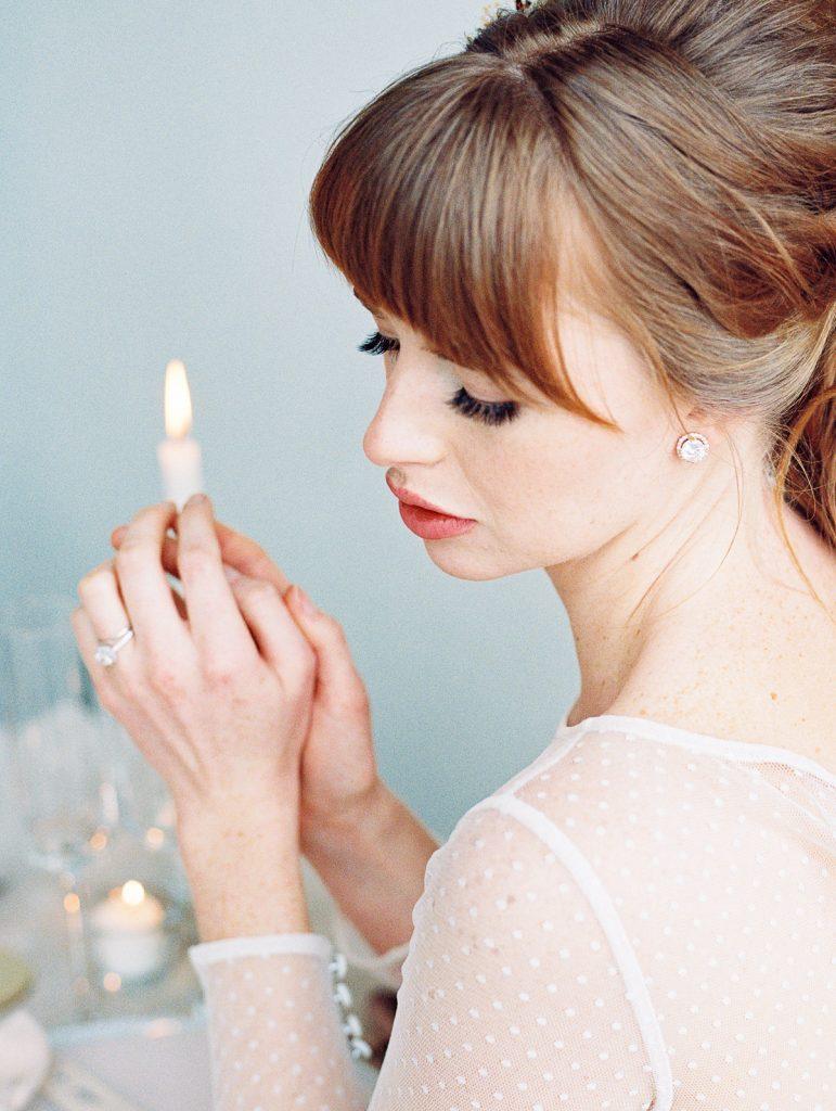 Close up portrait of the bride praying before enjoying her wedding dinner