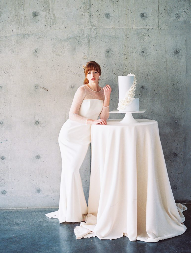 Bride waits patiently to cut into her dream wedding cake