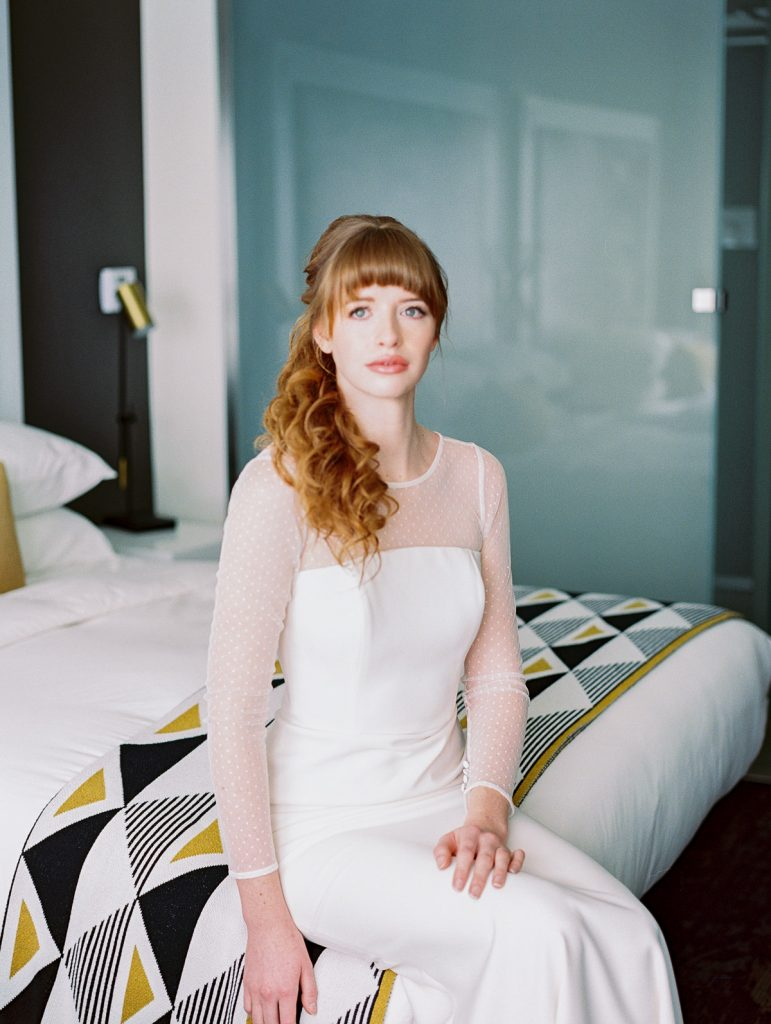 Oregon bride stares into the camera from her bed